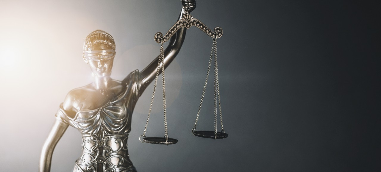 Lady Justice on a black background