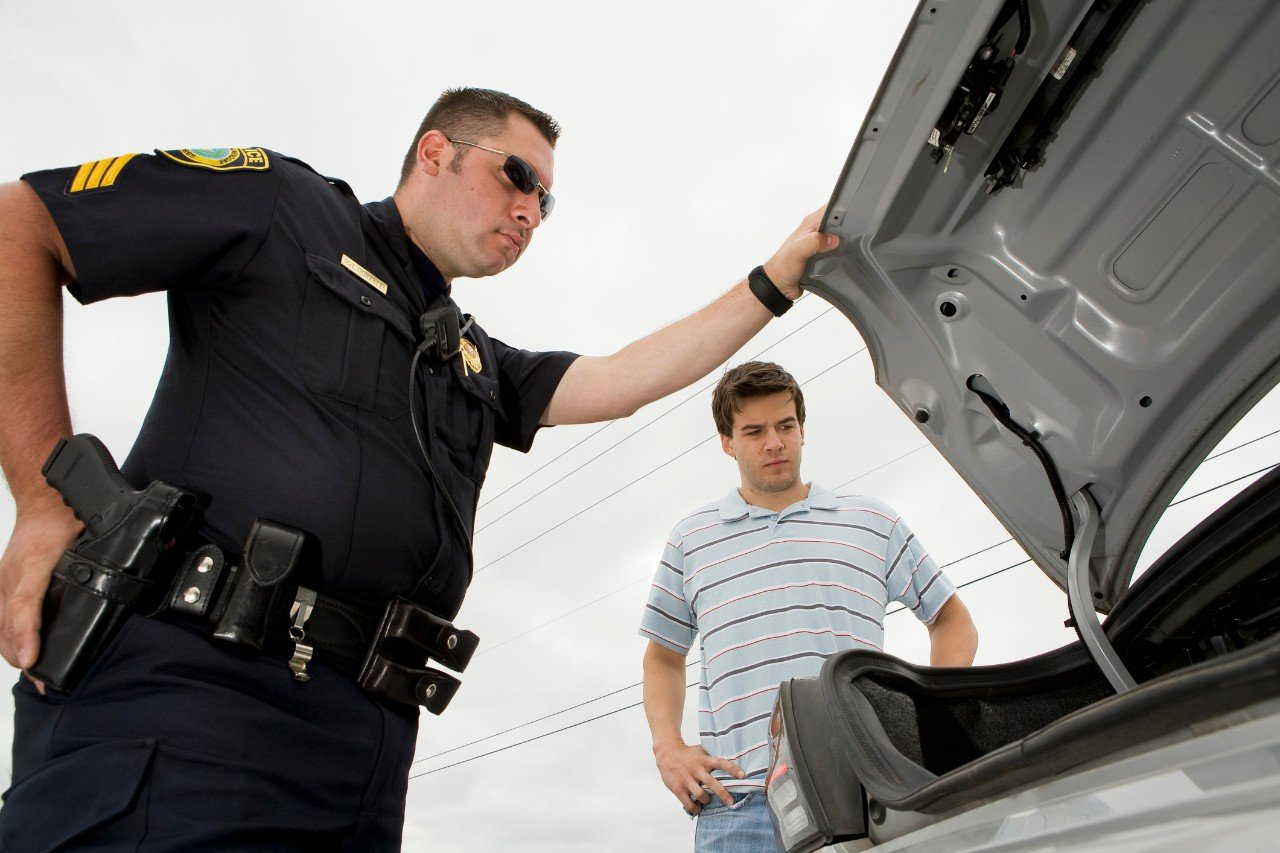 Police search a car trunk