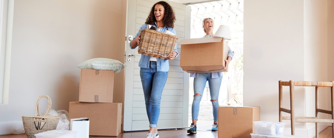 joint tenants or tenants in common carrying boxes to move into their new home