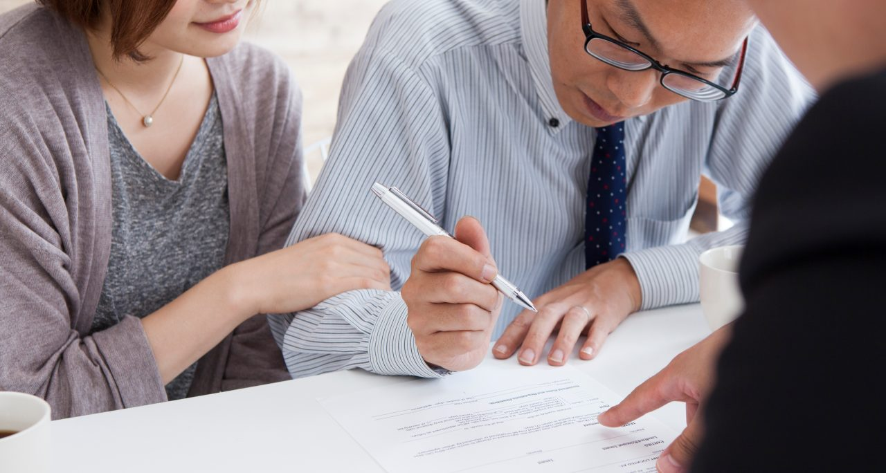 Client signing a real estate leasing contract in Landlord's office