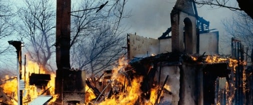 A home burning. Top Ten Tips For Filing Fire Insurance Claims